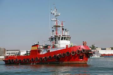 Red tug is underway on Black sea, Bulgaria