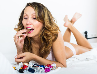 European woman eating chocolate candy