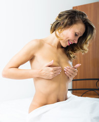 woman touching breasts