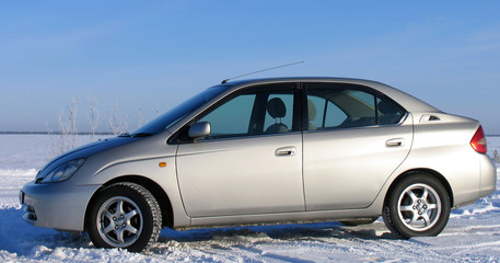 Toyota Prius V. Hybrid car on the background of nature.