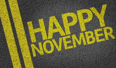 Happy November written on the road
