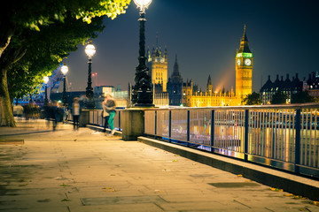 View of London England skyline and Big Ben seen at night.