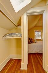 Small empty walk in closet interior