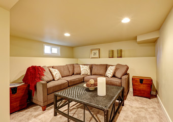 Cozy family room with comfortable sofa and wicker table