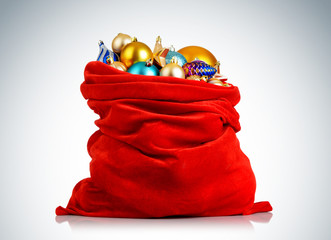 Santa Claus red bag with Christmas toys on background.