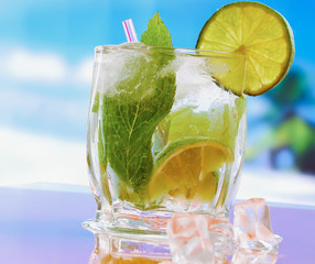 Mojito cocktail drink. Glasses with lime , ice, and leaf of mint