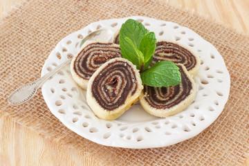 Brazilian chocolate dessert Bolo de rolo (swiss roll, roll cake)