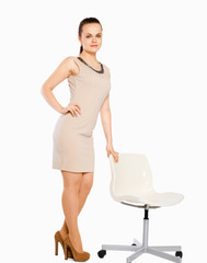 picture of young businesswoman and chair.