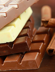 Stack of chocolate pieces on a wood background