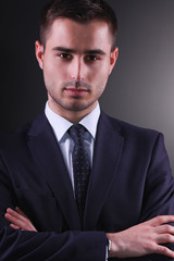 portrait of young man isolated on black  background