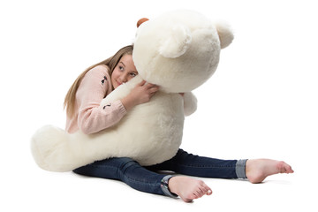 Image of girl hugging teddy bear