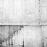 White concrete interior with stairway on the wall