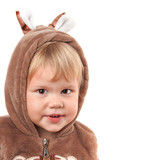 Portrait of smiling Caucasian baby girl in bear costume isolated