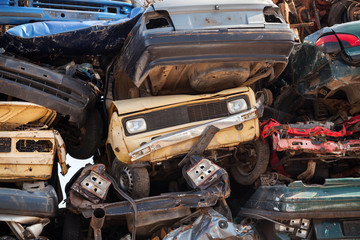 Abstract background with colorful dump of stacked cars in junkya