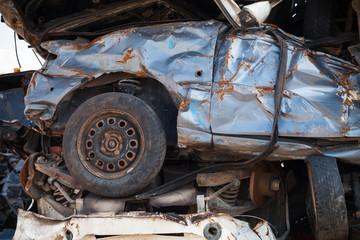 Fragment of stacked cars dumb in junkyard