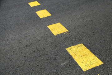 Pedestrian crossing road marking, yellow striped lines on asphal