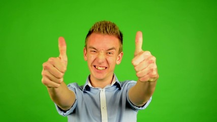 man - green screen - man agrees (shows thumbs up for approval)