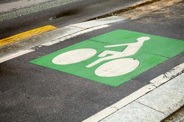 Bicycle lane. Green road marking on asphalt road