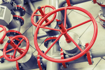 Red industrial valves on modern pipeline system