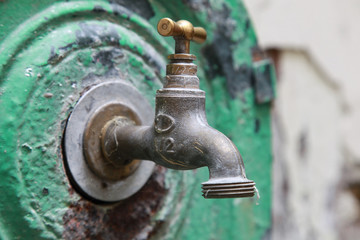 Closeup photo of old outdoor water valve