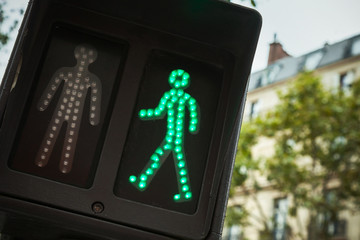 Pedestrian crossing traffic lights show green signal to go