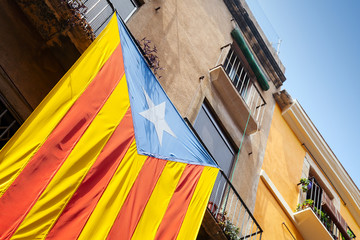 Flag of independent Catalonia hanging on facade of living house