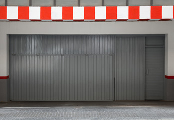 Empty urban interior with parking gate and striped border