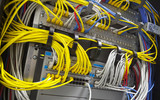 Large network hub and connected colorful cables