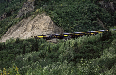 Passanger train in mountain landscape.