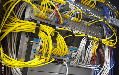 Large network hub and connected colorful cables - 71719557
