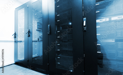 Modern server room interior with black computer cabinets - 71719576