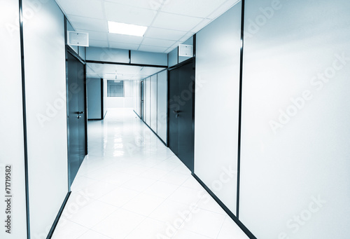 canvas print picture Abstract empty white office interior. Monochrome blue toned phot
