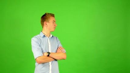 man - green screen - portrait - man waits (waiting)-watch