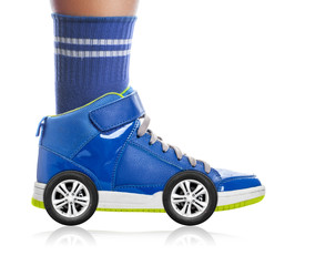 Blue Sport shoe with wheels isolated on white, speed concept