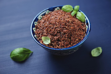 Ceramic pialat with red rice, horizontal shot, close-up
