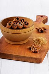 Anise star and cinnamon sticks on brown cane sugar