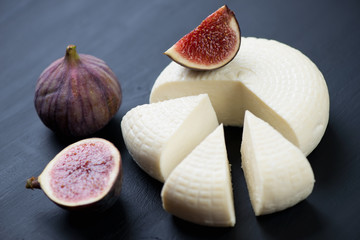 Close-up of sliced figs and cheese, horizontal shot