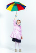 Cute little girl with colorful umbrella