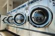 Leinwandbild Motiv line of laundry machine