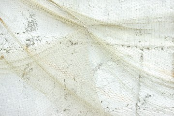 Old Fishing Net on White Wall