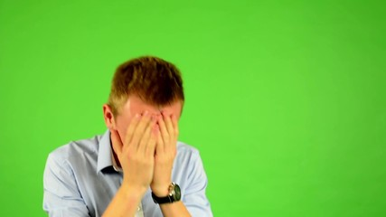 man - green screen - portrait - man is nervous