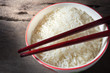 White rice in bowl with chopstick.