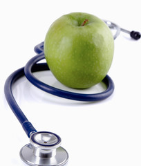 Stethoscope and green apple isolated on white background ,