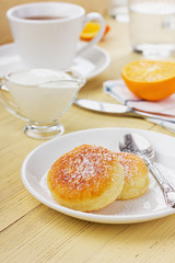 Fritters of cottage cheese with sour cream