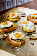 Sandwich with fried quail eggs, mushrooms and toast