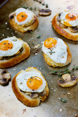 Breakfast with fried quail eggs, mushrooms and toast