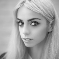 Black and white portrait of a blonde girl.