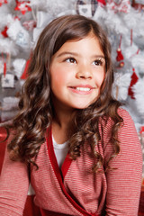 Portrait of a beautiful little girl at Christmas