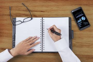 Businessman hands write business report