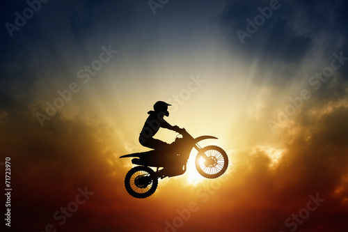 Biker on motorbike - 71723970